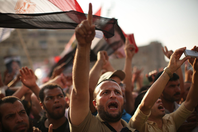 Muslim Brotherhood supporters protest in support of Morsi in Egyptng after government takeover by al-Sisi. (Photo: Getty Images)