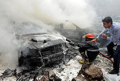 Car blast in Hezbollah stronghold (Photo: EPA)