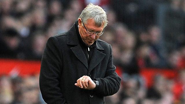 המאמן והשעון. זמן פרגי (צילום: AFP) (צילום: AFP)