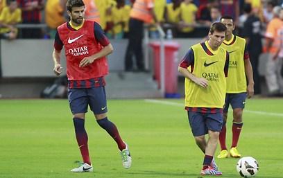 Pique and Messi at Bloomfield Stadium (Photo: Reuven Schwartz)