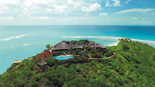 אי ירוק בים, וכולו שלו. הבית של ריצ'רד ברנסון באיי הבתולה (צילום: MCT)