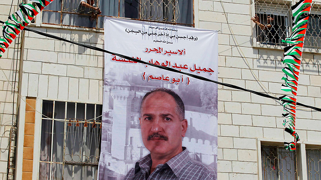 Poster of prisoner in Hebron (Photo: Reuters)