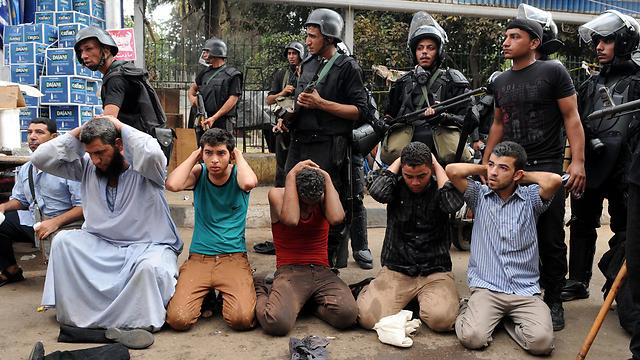 Morsi supporters arrested (Photo: EPA)