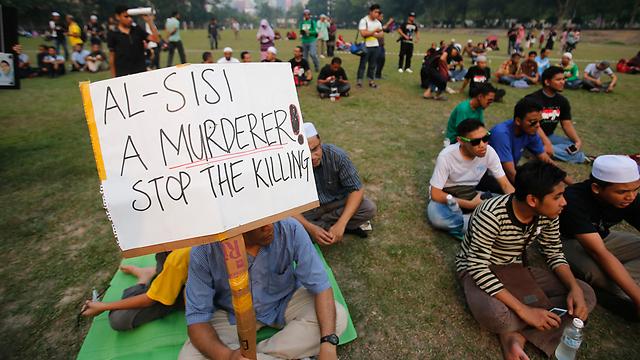 תומכי מורסי בקואלה למפור שבמלזיה  (צילום: רויטרס) (צילום: רויטרס)