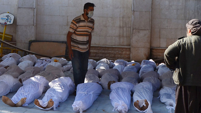 Victims of gas attack near Damascus (Photo: Reuters)