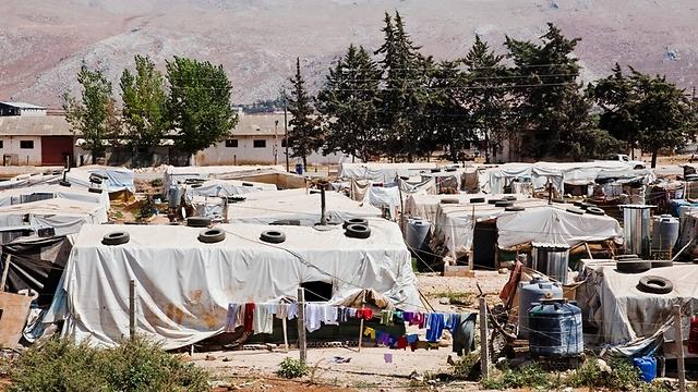 """במחנה בדאלמייה מתגוררים יותר מ-1,000 בני אדם ב-128 בתי מגורים מאולתרים (צילום: ס. בולדווין, סוכנות האו""""ם לפליטים) (צילום: ס. בולדווין, סוכנות האו"""