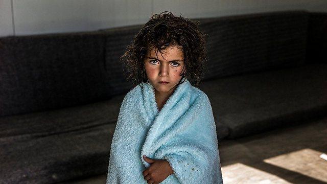 """דיוקנה של ילדה סורית שצולמה בביתה הארעי במחנה הפליטים זעתרי בירדן (צילום: ע. לבן-מטי, סוכנות האו""""ם לפליטים) (צילום: ע. לבן-מטי, סוכנות האו"""