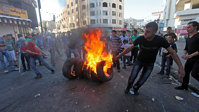 Riots in Hebron. There is a possibility of a major flare-up this year (Photo: EPA)