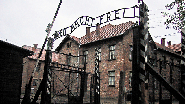 Entrance to the Auschwitz death camp. 'Survivors speak not only for themselves, but for the millions whose voices were violently silenced' (Photo: EPA)