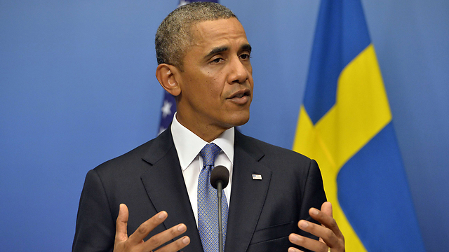Obama speaks to reporters in Stockholm (Photo: AFP)