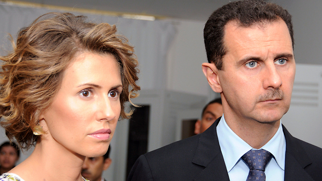 Asma al-Assad with Husband Bashar (Photo: AP)