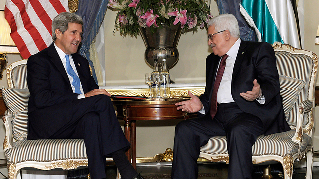 US Secretary of State John Kerry (left) with Palestinian President Mahmoud Abbas. (Photo: AP)