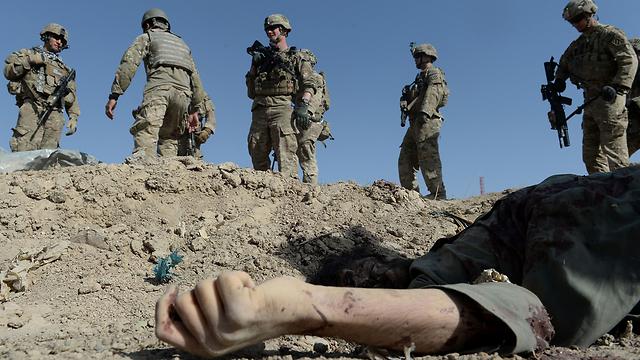 אחרי עשור של מלחמות, האמריקנים למדו על בשרם את מגבלות הכוח. אפגניסטן (צילום: AFP) (צילום: AFP)