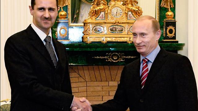 עומד לצד הנשיא הסורי מאז פרוץ המהפכה. פוטין ואסד (צילום: AP) (צילום: AP)