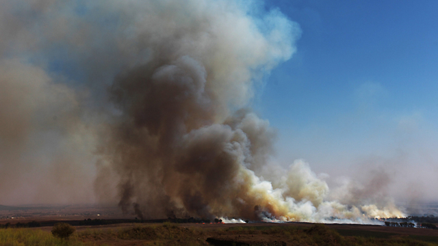 A shell bombing at the Israeli side of the border following Syrian overspill (Photo: EPA)