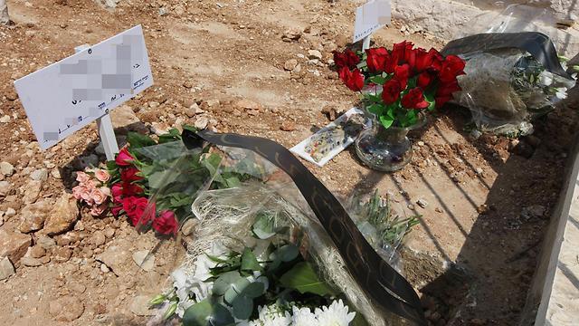 קברם של הילדים שנרצחו בירושלים (צילום: גיל יוחנן) (צילום: גיל יוחנן)