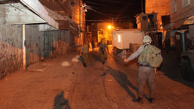 רחובות חברון לאחר הירי (צילום: גיל יוחנן) (צילום: גיל יוחנן)