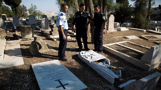 Desecrated graves in Christian cemetery (Photo: EPA)