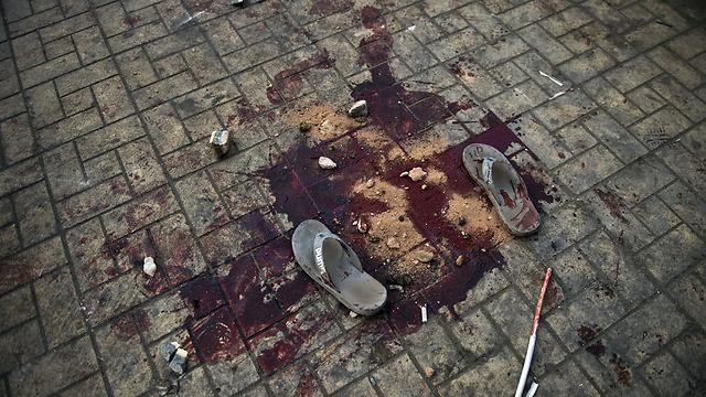 דם ברחבי מצרים ביום השנה למלחמת יום כיפור (צילום: AFP) (צילום: AFP)