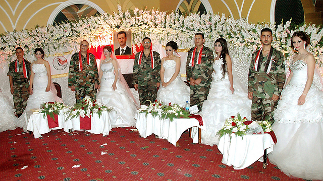 Wives Were Wed In A Hall Chock Full Of White Blossoms At The Center Which Portrait Syrian President Bashar Ad Was Proudly Hoisted