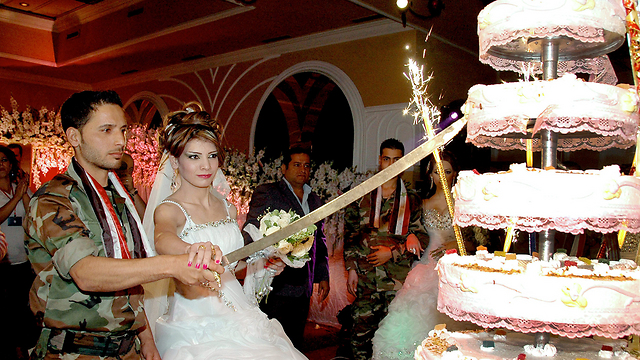 S Cutting A Seven Tiered Wedding Cake With Sword One Editorial Bitterly Remarked The Luxurious Was Cut While More Than 70 Of Syrians Are