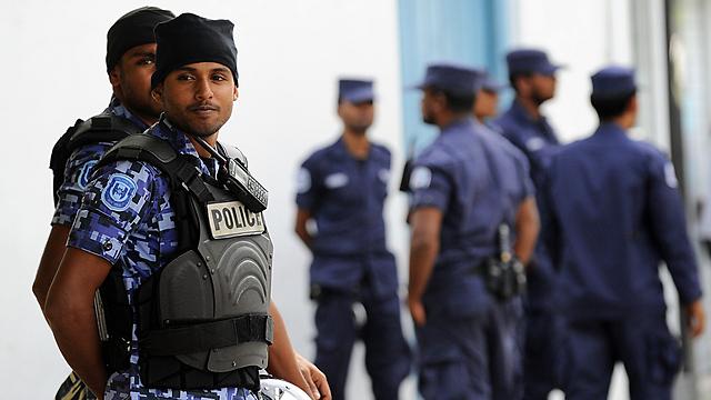 קציני משטרה חרגו מסמכותם? (צילום: AFP) (צילום: AFP)