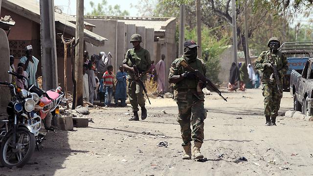 """הצבא הניגרי הרחיק את אנשי """"בוקו חראם"""" מהערים הגדולות (צילום: AFP) (צילום: AFP)"""