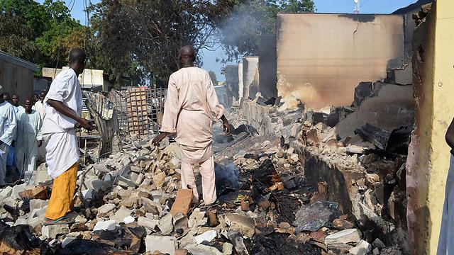 """אזור שהותקף על ידי """"בוקו חראם"""" בבורנו (צילום: רויטרס) (צילום: רויטרס)"""