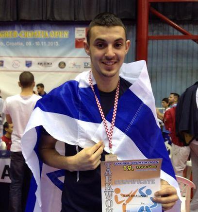 אילן ברגינסקי עם המדליה (צילום: ההתאחדות לטקוואנדו) (צילום: ההתאחדות לטקוואנדו)