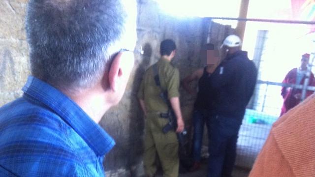 Terrorist, in black tank top, apprehended (Photo: Yair Gissar)