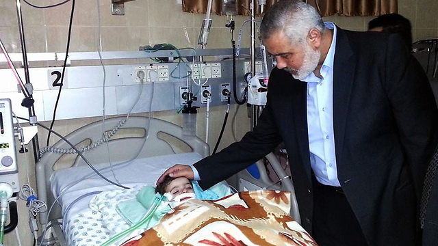 Hamas leader Ismail Haniyeh with his granddaughter, who was hospitalized at the Schneider Children's Medical Center in 2013. The study apparently does not apply to him