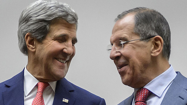 Kerry, Lavrov after deal reached with Iran (Photo: AFP)