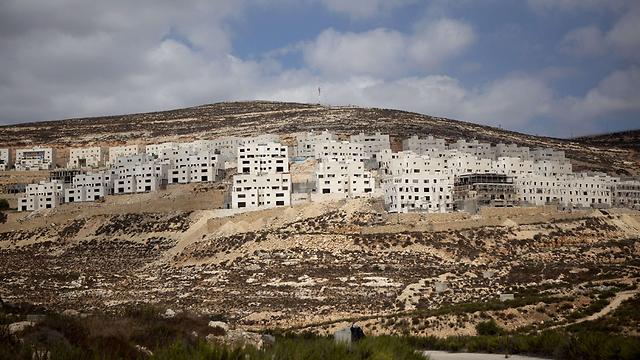 Settlement under construction (Photo: AFP)
