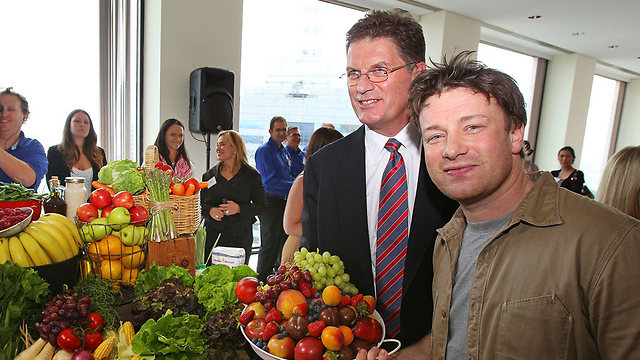 Chef Jamie Oliver, right, leading the Food Revolution in Britain (Photo: GettyImages)
