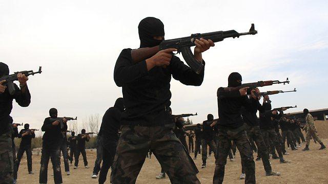 לוחמי ג'יהאד בסוריה. נקודת מוצא לטרור ברחבי העולם (רויטרס) (רויטרס)