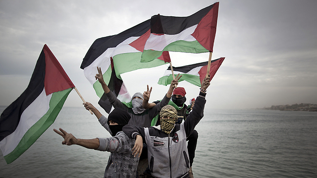 Palestinians in the Gaza Strip with the Palestinian flag (Photo: AFP)