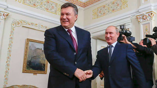 פוטין עם נשיא אוקראינה ינוקוביץ' (צילום: רויטרס)
