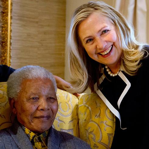 With Hillary Clinton, 2006 (Photo: AP)