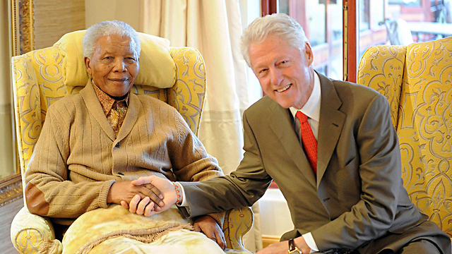 With Bill Clinton (Photo: Reuters)
