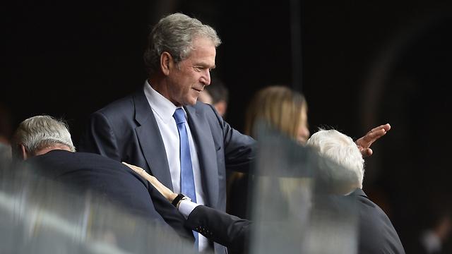 """נשיא ארה""""ב שקדם לאובמה, ג'ורג' בוש הבן (צילום: AFP) (צילום: AFP)"""