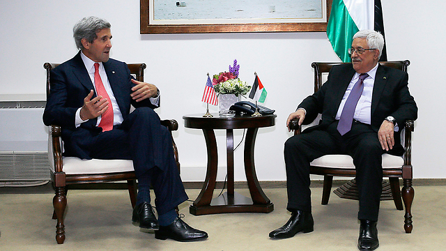 Abbas with Kerry (Photo: AP)