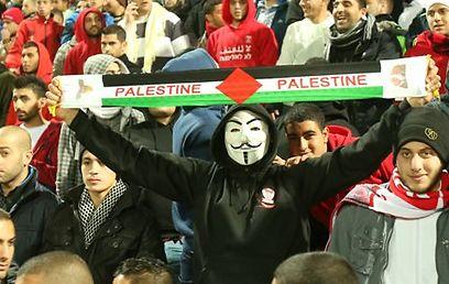 Palestinian flags in Sakhnin's stands were not a problem, Tibi opined (Photo: Elad Gershgoren)