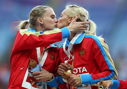 מהרגעים המקסימים של אליפות העולם באתלטיקה (צילום: GettyImages) (צילום: GettyImages)