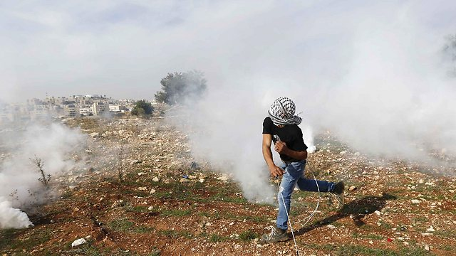 Palestinians protesting John Kerry's visit (Photo: Reuters)