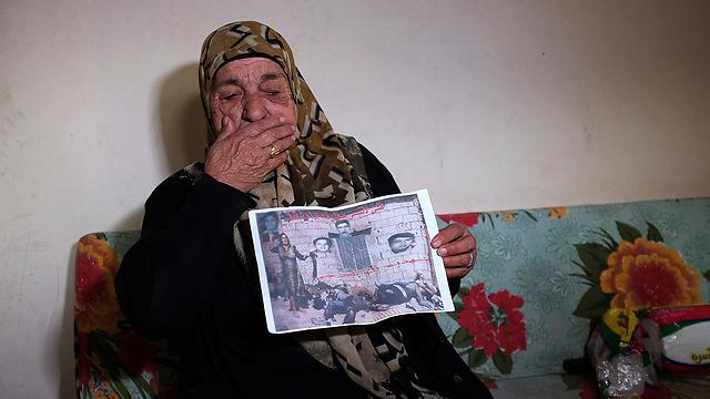 משפחתה נטבחה במחנות. מילאני בוטרוס אלחה בורג'ה (צילום: רויטרס) (צילום: רויטרס)