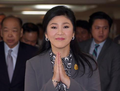 ניצלה את סמכותה לרעה. ראשת הממשלה המודחת יינגלוק (צילום: AP) (צילום: AP)