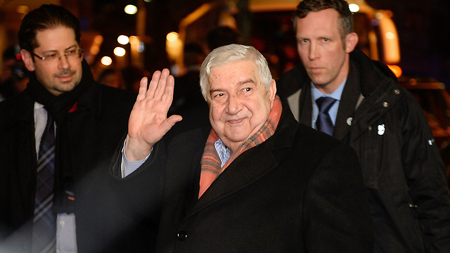 Syrian FM Moallem arrives at Geneva (Photo: AFP)