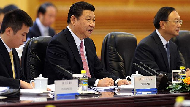 מעוניין להעלות את המורל בצבא. הנשיא שי ג'ינפינג (צילום: AFP)