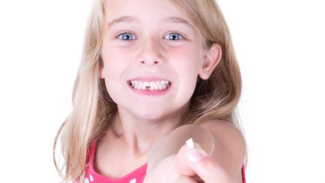 """""""מעניין כמה שיניים יש לך"""" (צילום: shutterstock) (צילום: shutterstock)"""