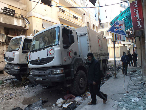Red Crescent trucks at Homs (Photo: Reuters) (Photo: Reuters)